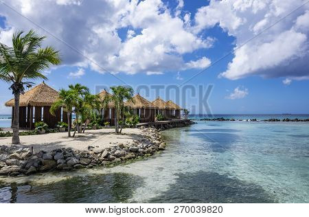Picturesque Renaissance Islands Of Aruba With Swaying Palm Trees And Private Gazebos