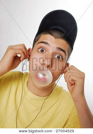 Young boy doing a bubblegum.