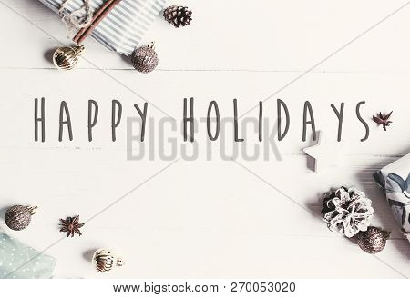 Happy Holidays Text On Modern Christmas Flat Lay With Ornaments And Gift Boxes, Top View With Space
