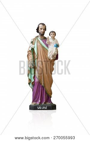 Statue Of Saint Joseph Emotionally Touched By The Passion Of The Boy Jesus.
