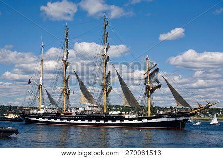 HALIFAX, NOVA SCOTIA, CANADA - AUG 20, 2009: The Kruzenshtern, sails down Halifax Harbour during the sailpast of the Nova Scotia Tall Ships Festival 2009.