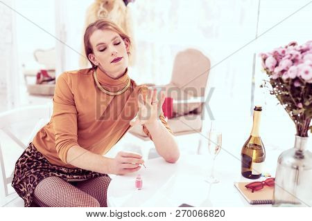 Fashionable Young Transgender Being Satisfied With His Work