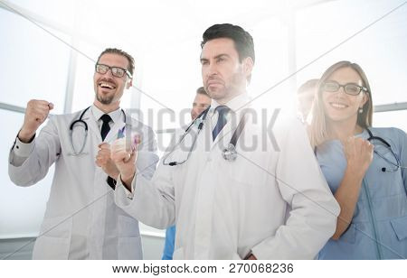 Smiling doctors, pumping fists and celebrating success.