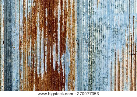 Rusty Dirty Tin Wall Background Textured Surface.