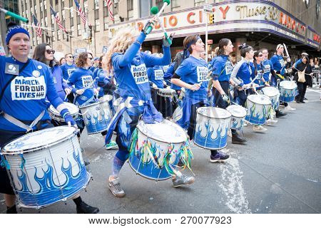 March For Our Lives: Women play drums in a drumline among other protesters in the march to end gun violence on 6th Ave, NEW YORK MAR 24 2018.