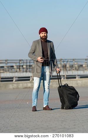 Carry Travel Bag. Business Trip. Man Bearded Hipster Travel With Big Luggage Bag On Wheels. Let Trav