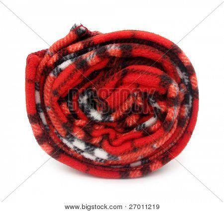 Blanket rug red rolled