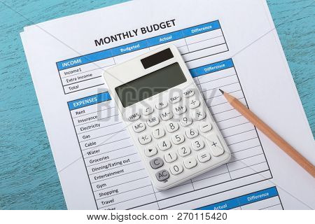 Monthly Budget Concept On Blue Wood Table