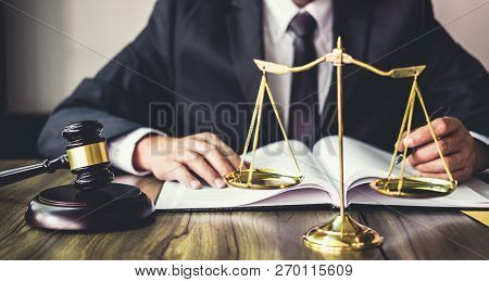 Judge Gavel With Justice Lawyers, Gavel On Wooden Table And Counselor Or Male Lawyer Working On A Do