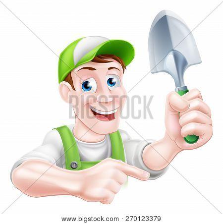 A Cartoon Gardening Mascot Gardener Man Holding A Garden Trowel And Pointing