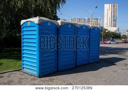 Portable Blue Bio Toilet Cabins In Park Lined Up For Event
