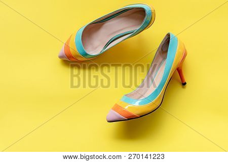 Fashion Woman Accessories Set. Trendy Fashion Colorful Shoes Heels. Yellow Pastel Color Background,