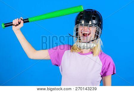 Girl Pretty Blonde Wear Baseball Helmet And Hold Bat On Blue Background. Beat Her Head With Bat. Dum