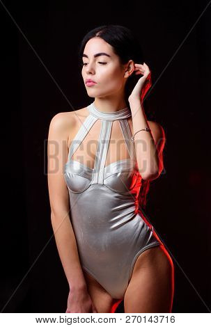 Lady Wear Sexy Spaceship Uniform Black Background. Futuristic Fashion Concept. Woman Wear Silver Fas