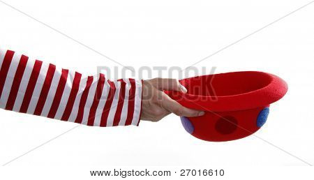 Clown hand is begging money with funny hat