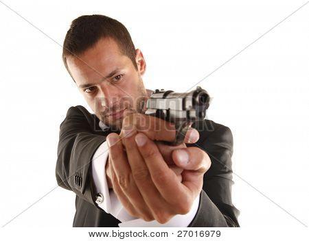 Handsome man aims with gun