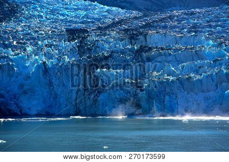 Ice Calving Off The Sawyer Glacier In The Tracy Arm Fjord, Alaska