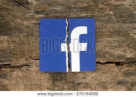 Kiev, Ukraine - November 07, 2018: Facebook Icon Printed On Paper, Torn And Put On Old Wooden Backgr