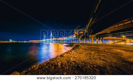 SAINT-PETERSBURG, RUSSIA - november 21, 2018: Time lapse evening highway, western high-speed diameter at sunset. Blurry cars on long exposure, Vasilievsky Island poster