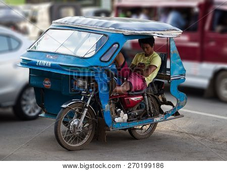 Palawan, Philippines - September 27, 2018: Tricycle Motorbike Taxi On City Street Waiting For Passen