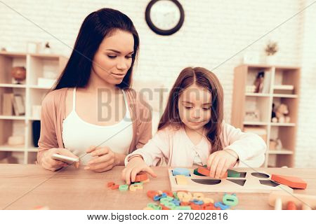 Mother Teaches Daughter. Educational Games. Learning Child At Home. Cubes And Puzzles. Child Develop