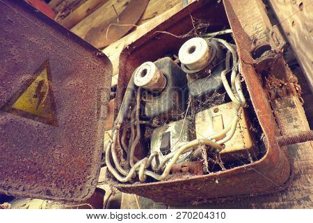 Overloaded Electrical Circuit Causing Electrical Short And Fire. Old Electric Power Supply Boxes. In