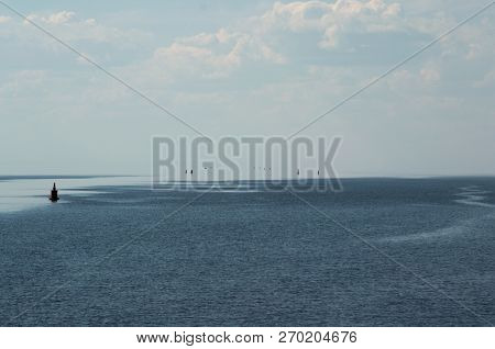 Waterway To The Sky. Buoys And Markers On The Beloe Lake In Belozersky District Of Vologda Oblast In