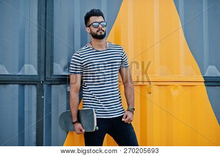 Handsome Tall Arabian Beard Man Model At Stripped Shirt Posed Outdoor. Fashionable Arab Guy At Sungl