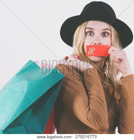 Woman In Hat Showing Tag With Shopping Sale Percentage Sign Enjoying Cheap Clothing.