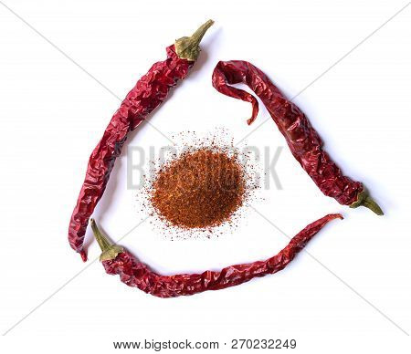 Dried Red Chili Pepper Isolated On White Background. Desiccated Milled Paprika. Top View Flat Lay. S