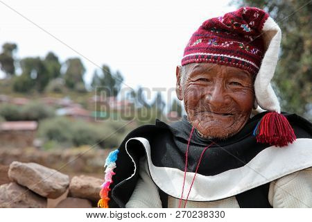 Puno, Peru - October 24, 2018: Unidentified Man In Traditional Outfit Specific For The Taquile Islan