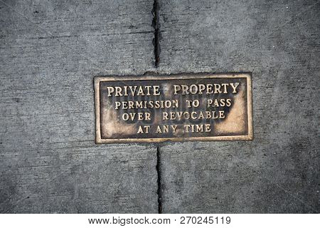 Metal Words in the Sidewalk. Old Metal Words imbedded in cement. Private Property Sign in brass.