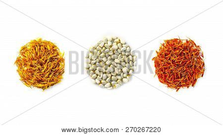 Yellow, Red Dried Safflower Petals And Seeds Carthamus Tinctorius Are Folded In The Form Of Circles
