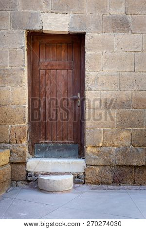 Old Wooden Door Framed By Bricks Stone Wall, Darb Al Ahmar District, Old Cairo, Egypt