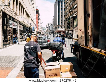 Cape Town, South Africa, February 9, 2018: Unloading delivery truck in downtown Cape Town, South Africa