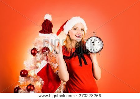 New Year Clock And Time Christmas. Glamour Celebration And Christmas Woman Dress. Merry Christmas An