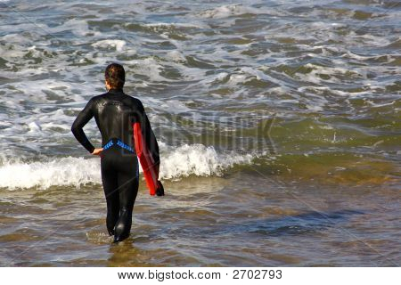 Surfer In The Shore