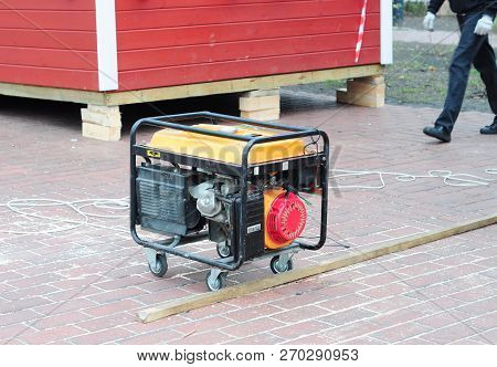 Backup Portable Generator For Repair. Mobile Backup Generator On House Construction Site.