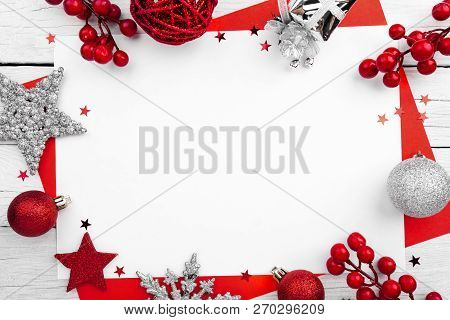 Christmas Ornament Made Of Red Adornment On Wooden Background