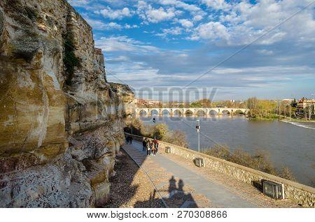 Zamora, Spain - March 25, 2016: People Walking On The Riverbank Of Duero River In Zamora (castilla Y