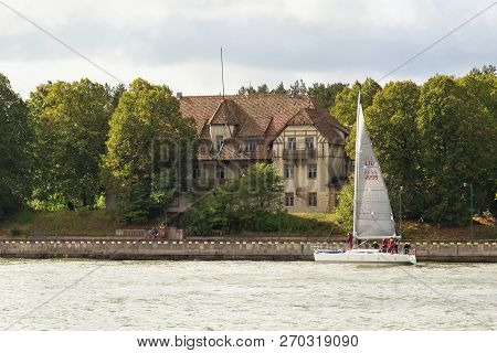 Klaipeda, Lithuania - September 22, 2018: Small Sail Yacht Are Sailing In The Waters Of The Curonian