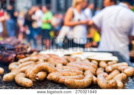 Close Up Sausages On Grill At Bbq Party