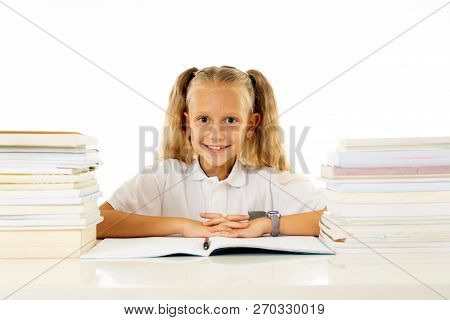 Cute Smiling Little Girl With A Pile Of Books Feeling Happy