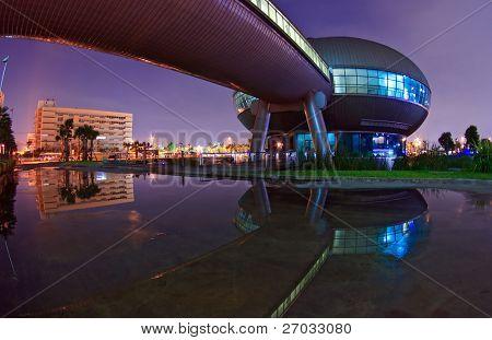 BANGKOK - SEP 25: Reflection of Government Sport Gymnasium shines at Dusk on Sep 25.2010 in Bangkok. Government Complex has 34 government units located at Chaeng Wattana Street in Bangkok.