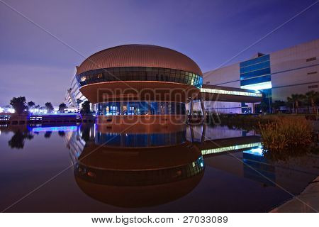 BANGKOK-SEP 25:Reflection of Government Sport Gymnasium shines at Dusk on Sep 25.2010 in Bangkok. Government Complex has 34 government units located at Chaeng Wattana Street in Bangkok.
