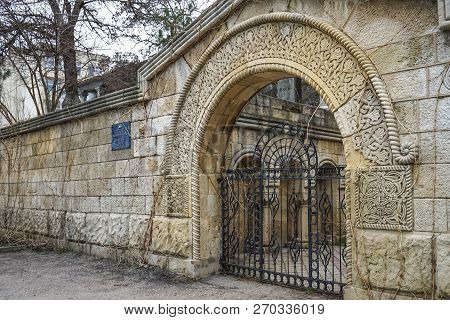 Feodosia, Crimea-march 20, 2015: Urban Landscape With An Ancient Stone Wall With Ornaments.