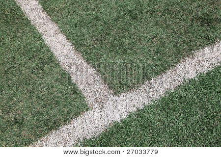 intersection of white line on soccer football field