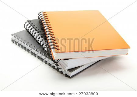 stack of ring binder book or notebook isolated on white