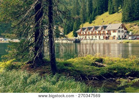 Auronzo Di Cadore, Italy August 9, 2018: Misurina Mountain Lake. Beautiful Tourist Place With Houses