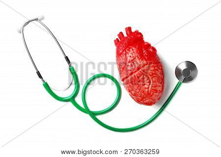 Stethoscope For Checking Pulse And Heart Model On White Background, Top View
